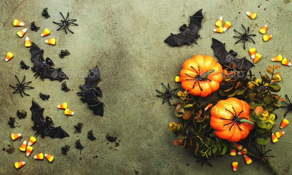 Happy Halloween swamp green background with pumpkins, bats, spiders, candy corn - Stock Photo - Images