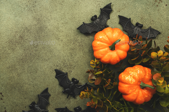 Happy Halloween swamp green background with pumpkins, bats with copy space - Stock Photo - Images