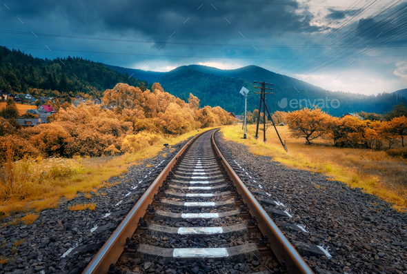 Rural railroad in mountains in overcast day. Old railway - Stock Photo - Images
