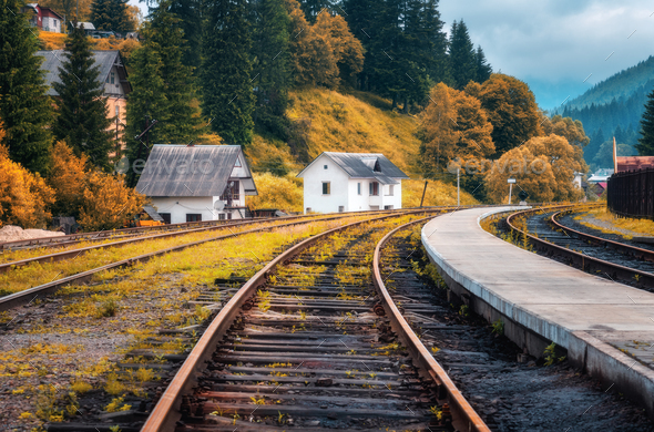 Railway station and white house in mountain village at sunset - Stock Photo - Images
