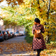 redhead woman walking at city street at sunny day. Autumn mood, foliage concept - PhotoDune Item for Sale