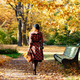 redhead woman in plaid coat and beret walks through the park at sunny day, back view. fall season - PhotoDune Item for Sale