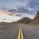 road through the wind erosion physiognomy in sunset - PhotoDune Item for Sale