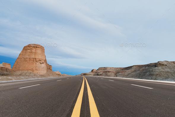 highway on wind erosion zone at dusk - Stock Photo - Images