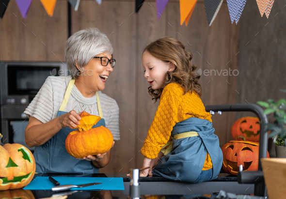 Happy family preparing for Halloween. - Stock Photo - Images