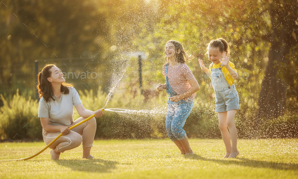 Happy family playing in backyard - Stock Photo - Images