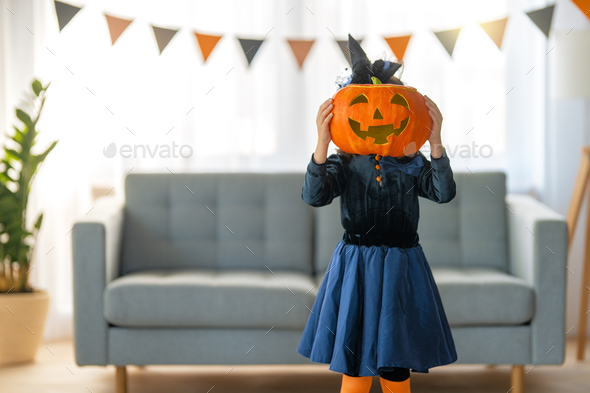 child with carving pumpkin - Stock Photo - Images