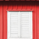 White wooden shutter on a red wall. - PhotoDune Item for Sale