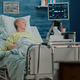 Elder patient with sickness laying in hospital bed - PhotoDune Item for Sale