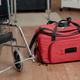 Close up of wheelchair and nursing bag on floor of nursing home - PhotoDune Item for Sale