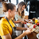 Portrait of happy young couple cooking together in the kitchen at home - PhotoDune Item for Sale