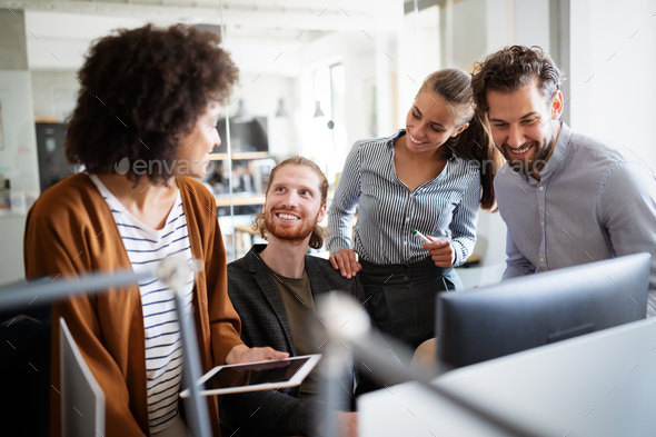 Software engineers working on project and programming in company - Stock Photo - Images