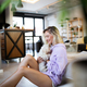 Lifestyle woman with her dog relaxing in living room - PhotoDune Item for Sale