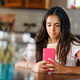 Attractive young teenage girl reading on her mobile phone - PhotoDune Item for Sale