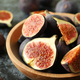 Bowl with fig on black smokey background - PhotoDune Item for Sale