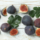 Fig with leaves on white wooden background - PhotoDune Item for Sale