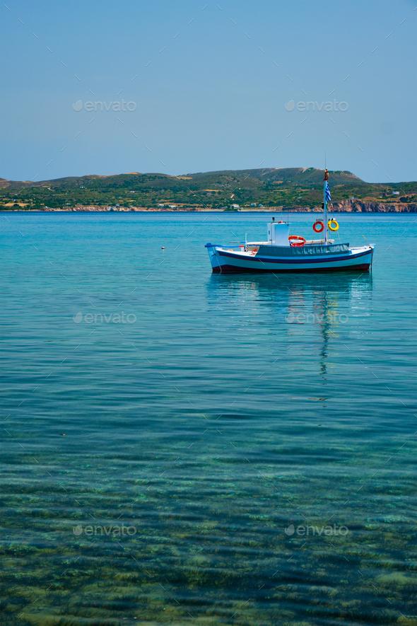 Greek fishing boat in Aegean sea near Milos island, Greece - Stock Photo - Images