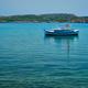 Greek fishing boat in Aegean sea near Milos island, Greece - PhotoDune Item for Sale