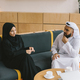 young muslim couple talking while sitting on cozy couch - PhotoDune Item for Sale