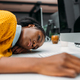 overworked young african american woman sleeping on work at modern office - PhotoDune Item for Sale