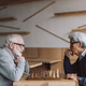 side view of multiethnic senior men playing chess - PhotoDune Item for Sale