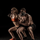 Muscular sportsman helping sporty young woman lifting barbell isolated on black - PhotoDune Item for Sale