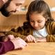 father and daughter choosing food in menu - PhotoDune Item for Sale