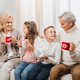 cute grandparents and kids with hot drinks in christmas decorated room - PhotoDune Item for Sale