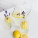 refreshing summertime lemonade with lavender flowers in glasses and jar on table - PhotoDune Item for Sale