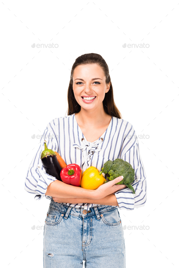 portrait of smiling woman with various fresh vegetables isolated on white - Stock Photo - Images