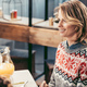 beautiful young woman in sweater at christmas table - PhotoDune Item for Sale