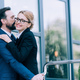 happy mature business people hugging and kissing while standing outside - PhotoDune Item for Sale