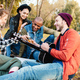 group of happy multicultural friends resting in park together - PhotoDune Item for Sale
