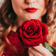 Beautiful woman holding a red rose - PhotoDune Item for Sale