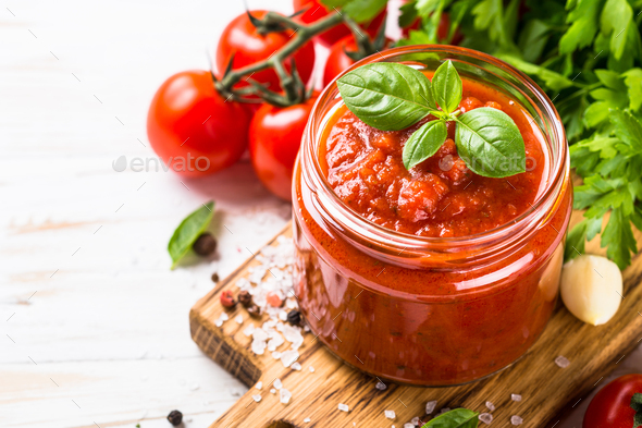 Tomato sauce with herbs and spices at white background - Stock Photo - Images