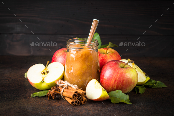 Apple jam with spices and fresh apples on dark background - Stock Photo - Images