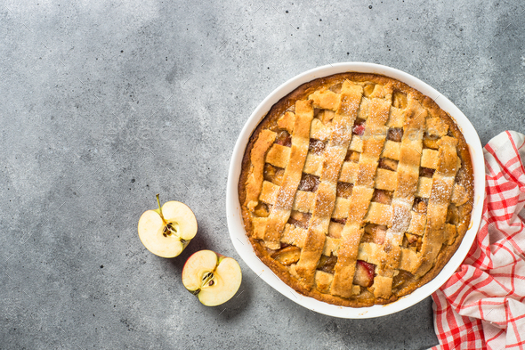 Apple pie with ginger and cinnamon at kitchen table - Stock Photo - Images