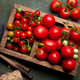 Fresh tomatoes and cherry tomatoes in wooden box - PhotoDune Item for Sale