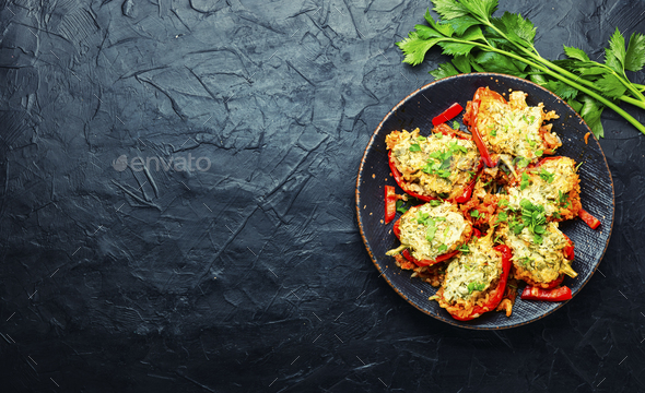 bell peppers stuffed with rice and meat - Stock Photo - Images