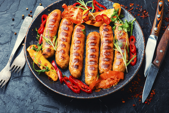 Fried sausages with bell pepper - Stock Photo - Images