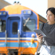 A teenage woman with headphones listening to music from an app on a tablet while waiting for a train - PhotoDune Item for Sale