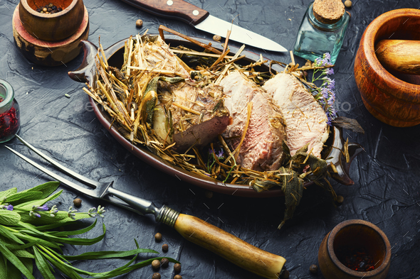Sliced roast in hay, pork roulade - Stock Photo - Images