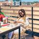 Woman looking cell phone and having a milkshake - PhotoDune Item for Sale