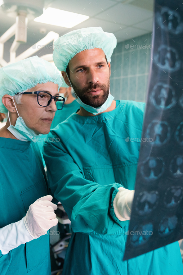 Portrait of intellectual healthcare professionals with at x-ray radiographic image, ct scan, mri - Stock Photo - Images