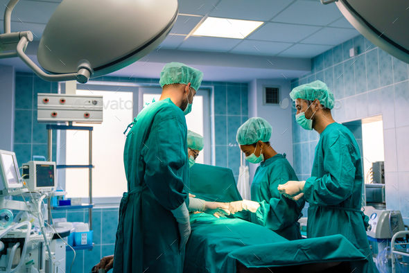Group of surgeon at work in operating room in hospital - Stock Photo - Images