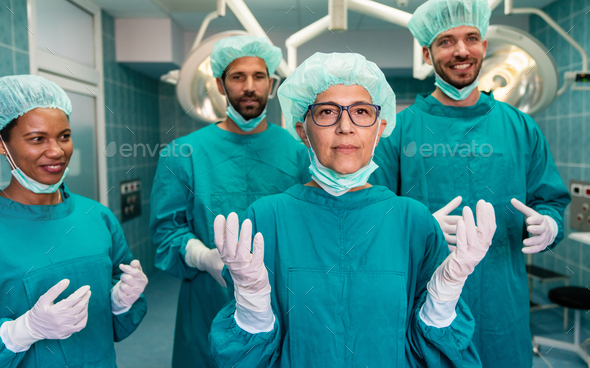 Successful team of surgeon standing in operating room, ready to work on a patient - Stock Photo - Images