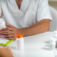 Quantum Medicine. Doctor Holding a Supplement Bottle, recommending supplements to a client. - PhotoDune Item for Sale