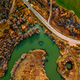 Aerial view of winding river and road in golden colored fall forest - PhotoDune Item for Sale