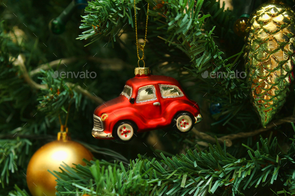 Red car toy, cone and ball on Christmas tree - Stock Photo - Images