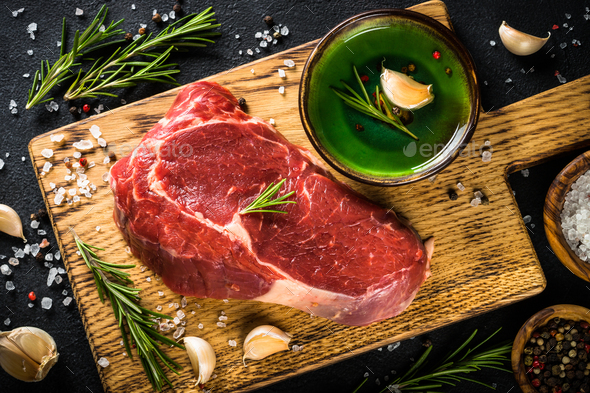 Raw beef steak with herbs - Stock Photo - Images